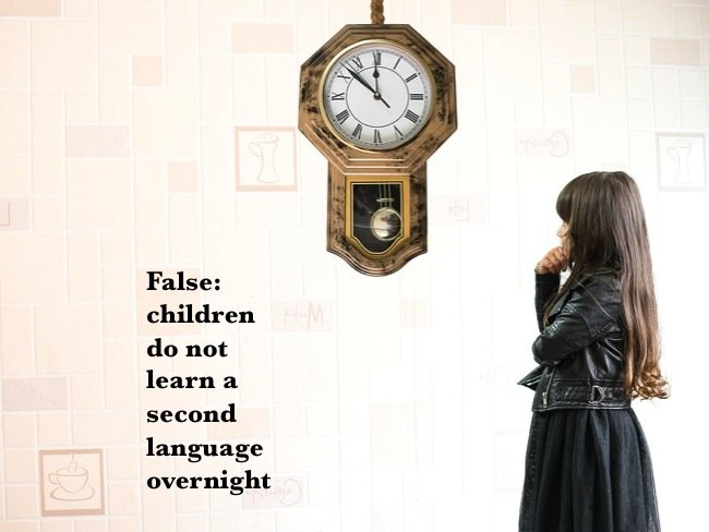 False: children do not learn a second language overnight